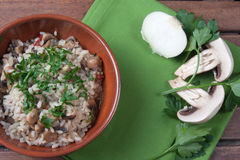 Rice with Champignon mushroom. Typical dish of traditional Italian cuisine Stock Photo