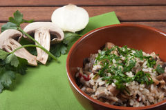 Rice with Champignon mushroom. Typical dish of traditional Italian cuisine Royalty Free Stock Photography