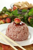 Rice with cherry sauce Stock Photo