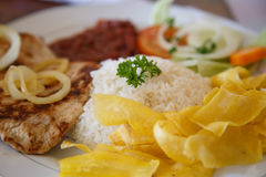 Rice with chicken, beans and salad. From Nicaraguan cuisine stock images