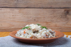 Rice with chicken on a clay plate on linen napkin Royalty Free Stock Photo