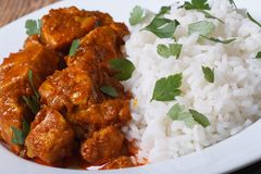 Rice with chicken curry and herbs closeup on plate royalty free stock images