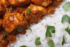 Rice with chicken curry and herbs macro. stock photos