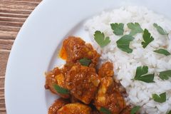 Rice with chicken curry on a plate close-up top view Stock Photo