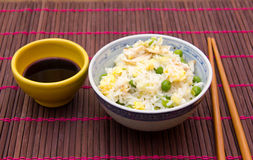 Rice with chicken and eggs on the placemat Royalty Free Stock Photography