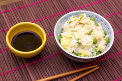 Rice with chicken and eggs on the placemat close Stock Photography