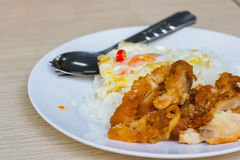 Rice with chicken and fried egg. On the plate Royalty Free Stock Photography