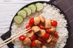Rice with chicken and teriyaki sauce horizontal top view Royalty Free Stock Photos