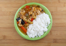 Rice with chicken. And vegetable on green plate Royalty Free Stock Photos