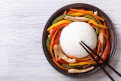 Rice with chicken, vegetables and chopsticks  top view Stock Photography