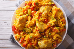 Rice with chicken and vegetables closeup. horizontal top view. Rice with chicken and vegetables close up in a bowl on the table. horizontal top view Royalty Free Stock Image