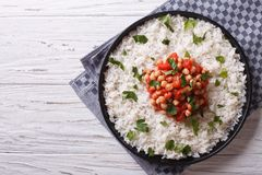 Rice and chickpeas in a tomato sauce horizontal top view Royalty Free Stock Photography