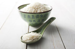 Rice in a Chinese Green Bowl and Scoop Royalty Free Stock Images