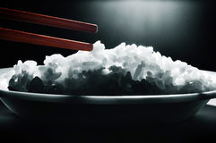 Rice and chopsticks. A bowl fo rice and chopsticks stock images