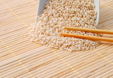 Rice with chopsticks on bamboo. Background Stock Photos