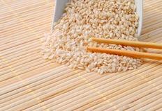 Rice with chopsticks on bamboo Stock Photos