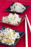 Rice with chopsticks in bowls Royalty Free Stock Images