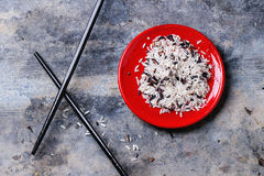 Rice with chopsticks Stock Images