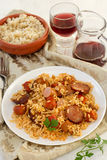 Rice with chorizo and sausages and wine Royalty Free Stock Images