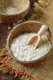 Rice in coconut bowl. Raw rice in coconut bowls Royalty Free Stock Image