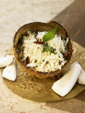 Rice with coconut,chili peppers and mustard seeds Stock Photo