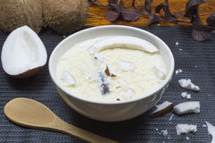 Rice with coconut milk. Sweet rice with coconut milk on the table Royalty Free Stock Images