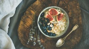 Rice coconut porridge with figs, berries and hazelnuts in bowl Royalty Free Stock Photo
