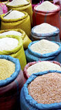 Rice in colorful sack Stock Photos