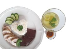 Hainanese Chicken Rice. Rice cooked with chicken fat and boiled Chicken and Chicken blood served with Cucumber Soup And  salted soy beans sauce Stock Image