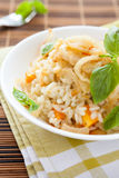 Rice cooked with pumpkin and onions Stock Photo