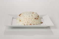 Rice. Cooked Rice on a Square Plate Royalty Free Stock Photos