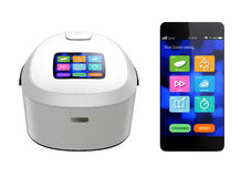 Rice cooker and smart phone  on white background Royalty Free Stock Image