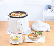 Rice cooking and electric casserole pot Stock Photography