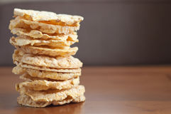 Rice or corn cakes stacked on wooden background Stock Photography