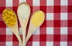 Rice, couscous and macaroni tablecloth background Stock Images