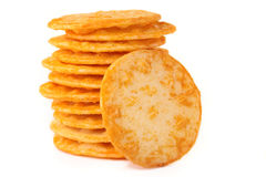 Rice crackers. A stack of cheesy rice crackers on a white background Royalty Free Stock Photo
