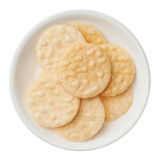 Rice crackers in a bowl isolated on white background Royalty Free Stock Photo