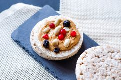 Rice crisps with peanut butter, berries and peanuts royalty free stock image