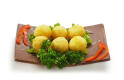 Rice Croquette. Deep Fried Rice Croquette with Salmon and Cream Cheese. Garnished on Salad Leaf with Bell Pepper and Parsley Stock Photography