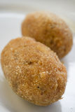 Rice croquettes with filling of mozzarella Stock Images