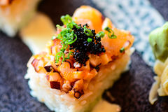 Rice Cube Sushi. Topped with spicy tako octopus stock photos