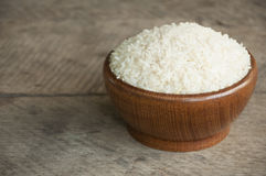 Rice cup. White rice in wood cup have wood table is backgruond Royalty Free Stock Images