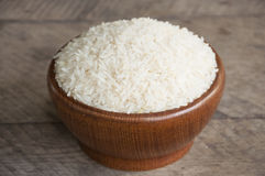 Rice cup. White rice in wood cup have wood table is backgruond Royalty Free Stock Photos