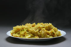 Rice with curry. Rice with vegetables and curry in plate on neutral bacground Stock Images