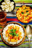 Rice with curry chickpeas with vegetables and Arabic flat bread Royalty Free Stock Images