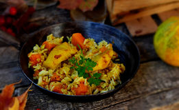 Rice curry with fried fish and pumpkin Stock Photos