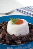 Rice with cuttlefish. Black rice with cuttlefish and tomatoes Stock Photo