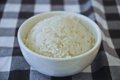 Rice of delicious legendary Singaporean Hainanese chicken rice. Rice of delicious legendary Singaporean Hainanese chicken fluffy steamed rice in a ceramic Stock Image