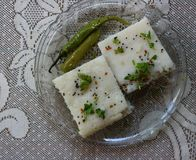 Rice dhokla on a plate. Rice dhokla on a transparent glass plate Royalty Free Stock Images