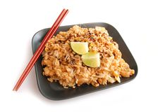Rice dish. Asian rice dish served on black plate with chopsticks. Isolated on white background Royalty Free Stock Photos